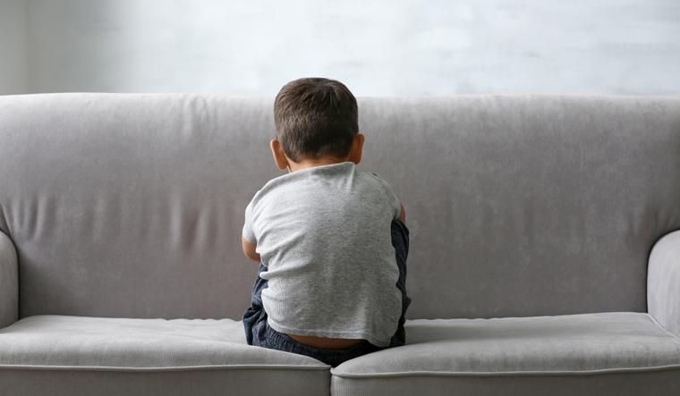 child-autism-autstic-sitting-sofa-sad-shut