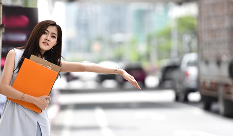 girl-waiting-bus-taxi-showing-hand-shut