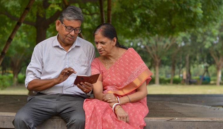 senior-citizen-happy-retired-life-pensioner-pension-mobile-phone-park-message-shut