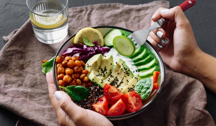 woman-eating-vegetables-veg-food-vegetarian-food-shut