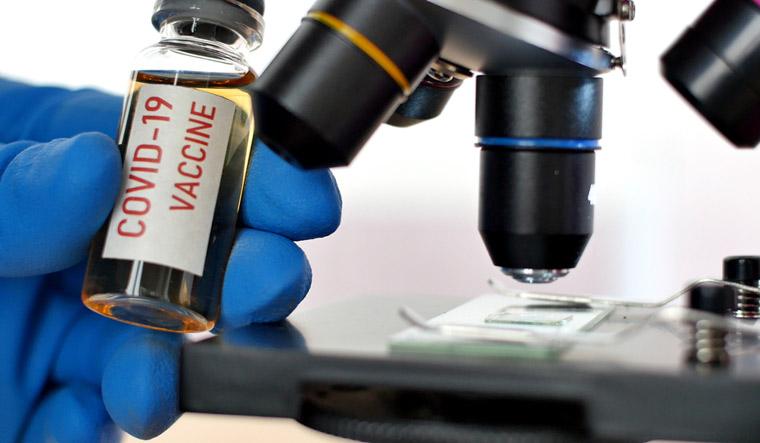 covid-vaccine-microscope.-Coronavirus-2019-nCoV-COVID-shut