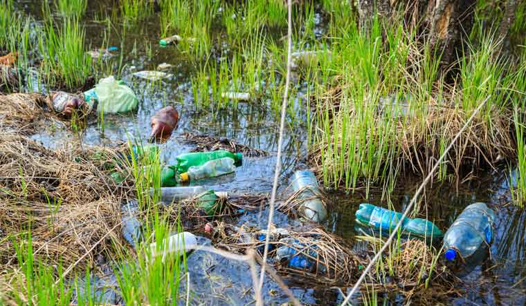 environmental-pollution-plastic-waste-bottles-shut