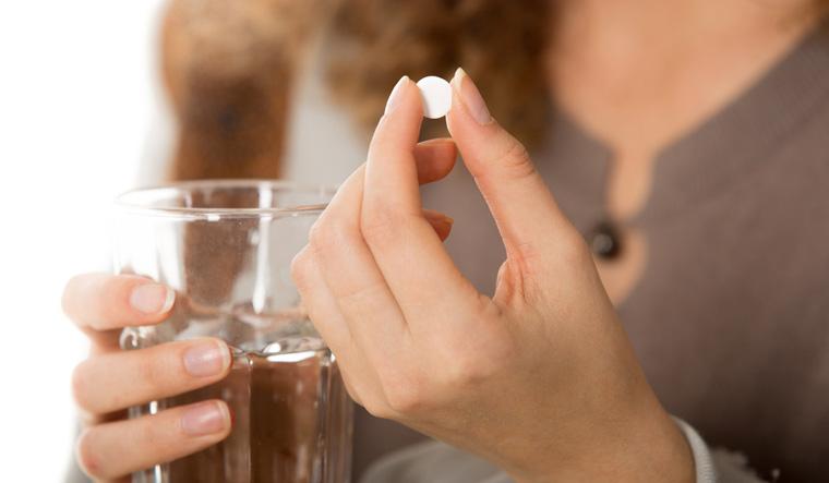 tablet-antibiotic-medicine-woman-shut