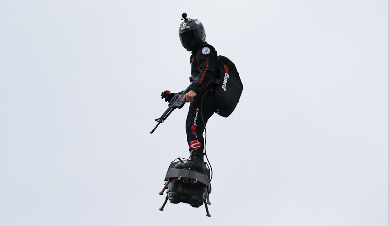 Rifle-carrying French inventor pilots 'flyboard' in air above Paris