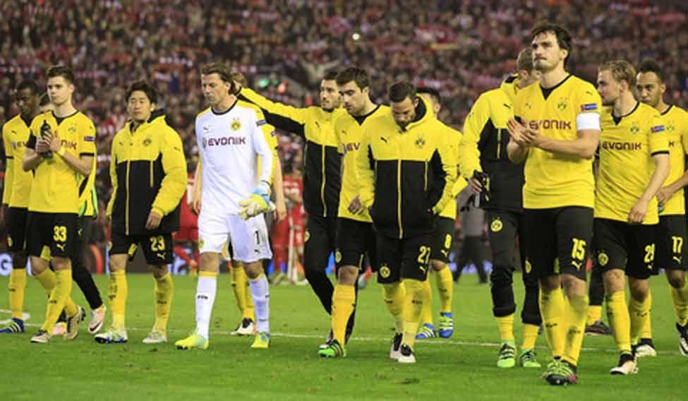 Liverpool stun Dortmund, Sevila edge through