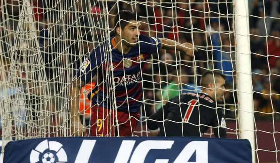Suarez makes history as Barca, Real, Atletico win
