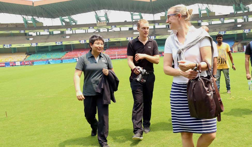 Project Lead for the FIFA U17 World Cup, 2017 Tracy Lu (L) with other officials visit the Jawaharlal Nehru Stadium in Kochi
