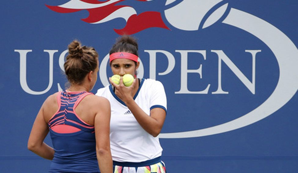 Sania Mirza, of Inida talks with doubles partner Barbora Strycova, of the Czech Republic