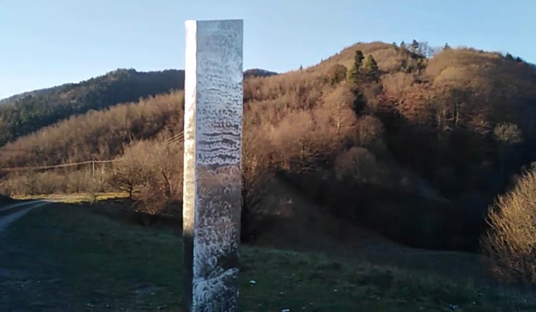The 'new' monolith—if it can be called that—also has a mirrored surface, and appears to have already been covered with graffiti | Twitter