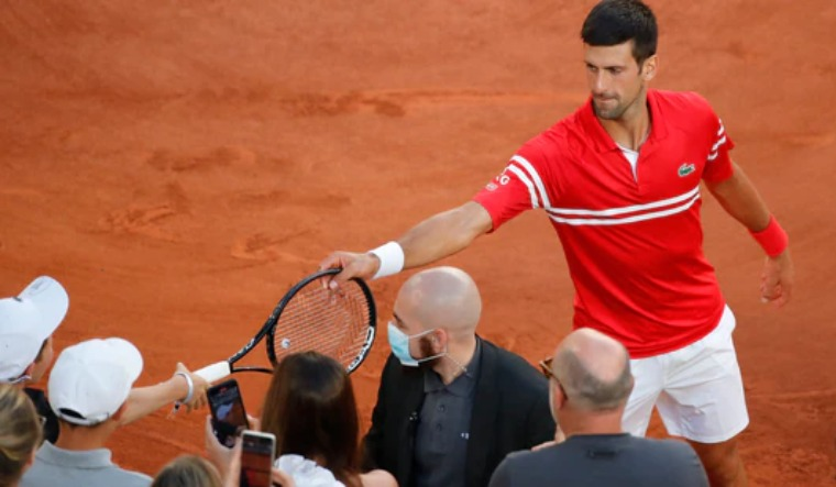 Djokovic gifts racket to supportive young fan