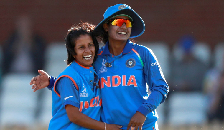 Poonam Yadav celebrates with Raj after taking the wicket of Australia's Ashleigh Gardner during the World Cup | Reuters