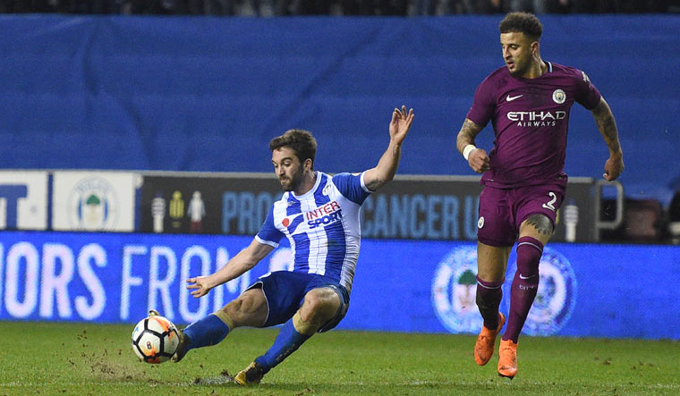 Morsy missing as Wigan prepare to host Manchester City