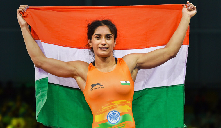 Wrestlers Vinesh Phogat, Sumit Malim win CWG gold