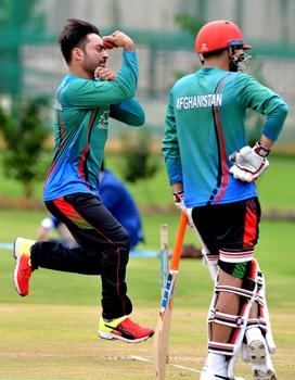 Rashid Khan (left) trains with his team | AFP