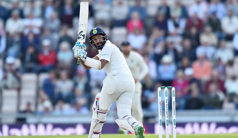 Cheteshwar Pujara plays a shot | AFP