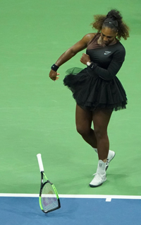 Serena Williams smashes her racquet during the US Open final | AFP