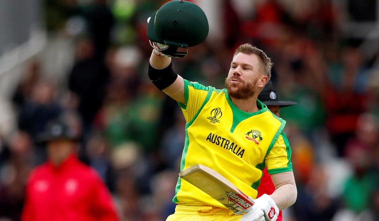 World Cup: Warner's ton takes Australia to 381/5 in rain-hit match