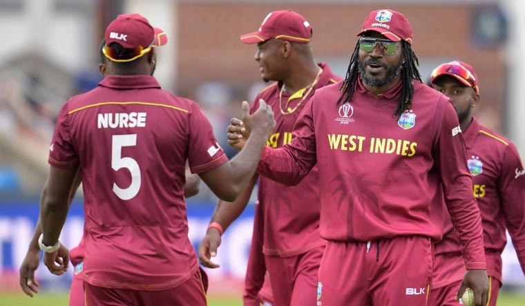West Indies beat Afghanistan by 23 runs to end on winning