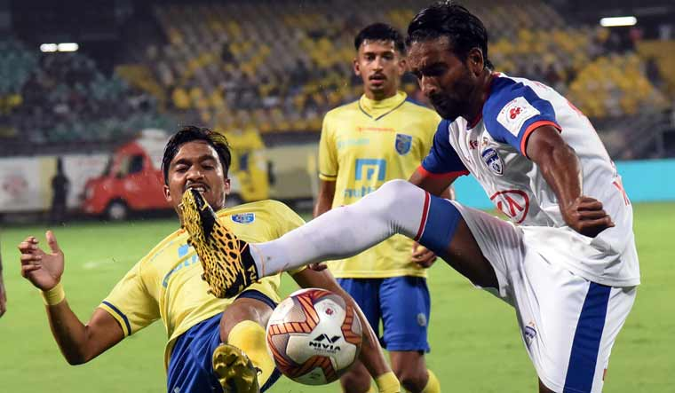 Players of Kerala Blasters FC (in yellow) and Bengaluru FC in action during their ISL match in Kochi | PTI