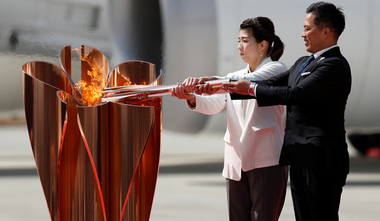 Intense pushback as International Olympic Committee insists Tokyo Olympics will go ahead as scheduled