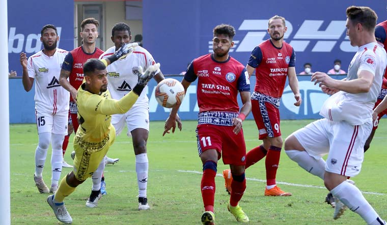 TP Rehenesh, goalkeeper of Jamshedpur FC, saves a goal during the Indian Super League match between Jamshedpur FC and NorthEast United FC in Goa | PTI