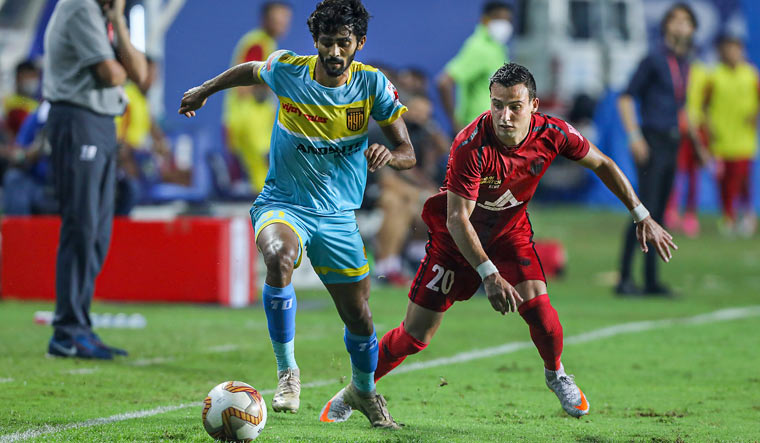 Akash Mishra of Hyderabad FC and Luis Miguel Machado of NorthEast United FC in action | PTI