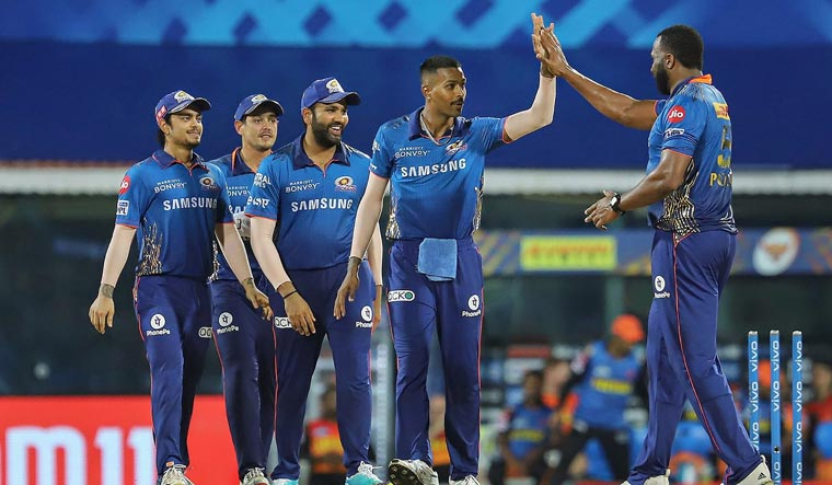 Mumbai Indians players celebrate the runout of David Warner, captain of Sunrisers Hyderabad | PTI