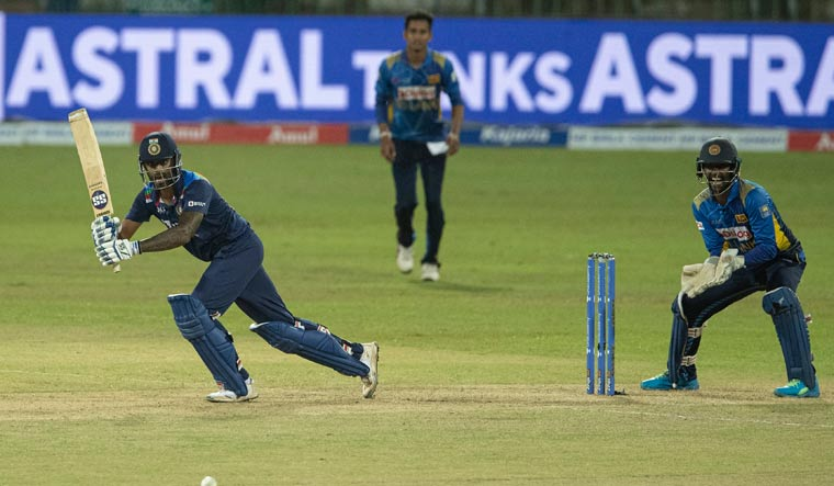 Suryakumar Yadav plays a shot as Sri Lankan wicketkeeper Minod Bhanuka watches   AP