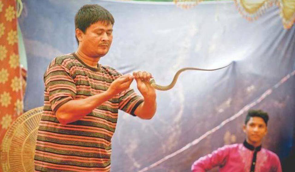 snake-eating-man