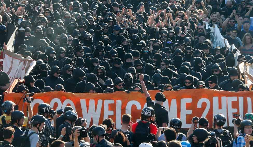 39 welcome to hell 39 rally greets trump 39 s maiden g20. Black Bedroom Furniture Sets. Home Design Ideas