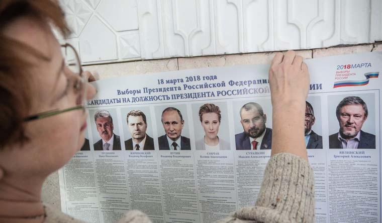 Isolated but defiant, Russia set to re-elect strongman Putin