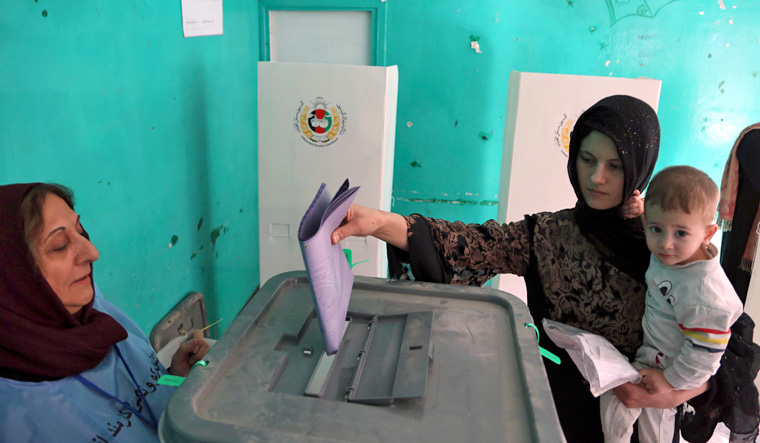 Amid Taliban threats, Afghans vote in parliamentary elections