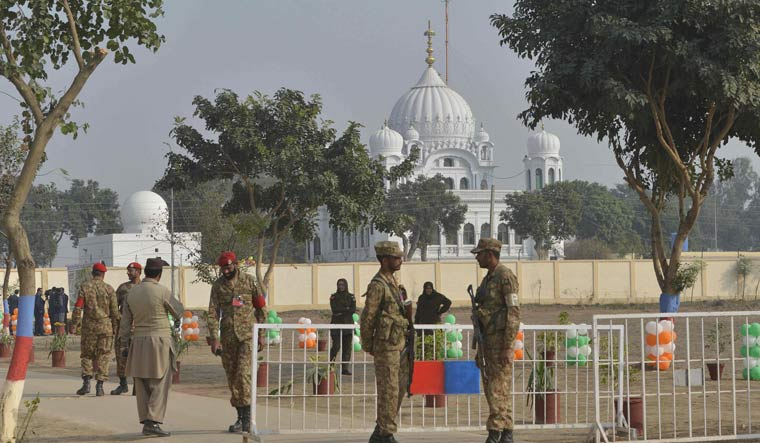 Pakistani army soldiers gather in front of Kartarpur Gurdwara Sahib during the groundbreaking ceremony for the Kartarpur Corridor in Kartarpur on November 28 | AFP