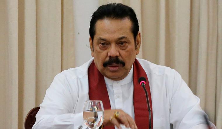 Disputed Sri Lanka PM Mahinda Rajapaksa to resign on Saturday, says his son
