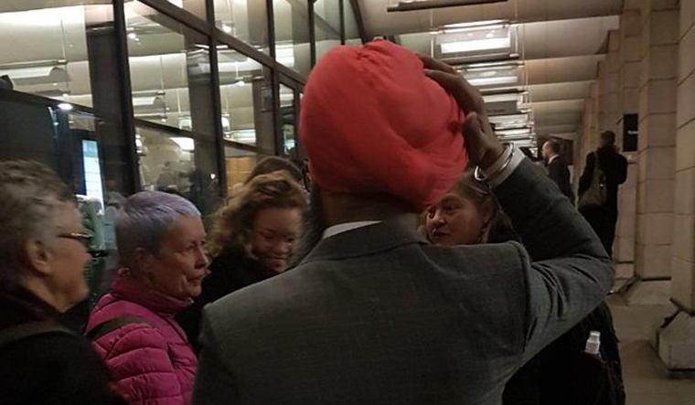 'Muslim go back': Indian Sikh's turban ripped outside UK parliament
