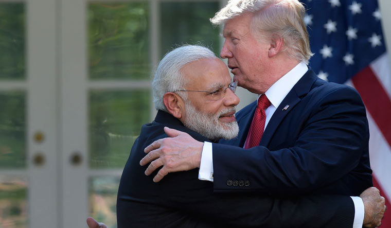 US President Donald Trump being hugged by Prime Minister Narendra Modi | Reuters