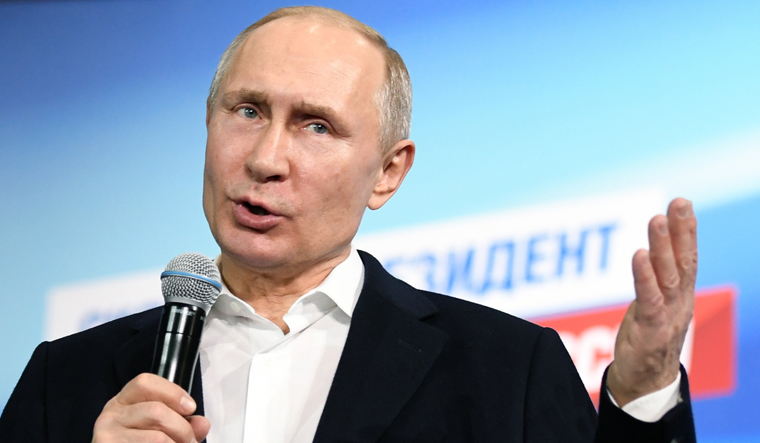 Putin says 'nonsense' to think Russia would poison spy in Britain