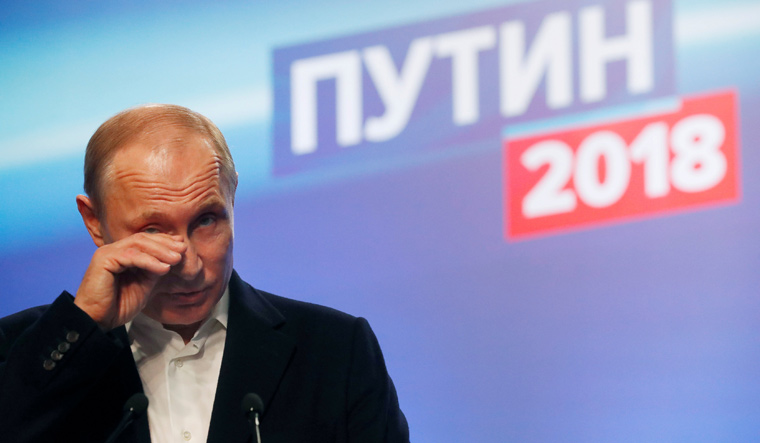 Putin easily wins another six-year term, firms grip on Russia