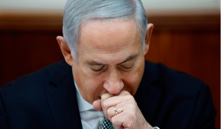 Benjamin Netanyahu questioned by Israeli police about corruption scandal