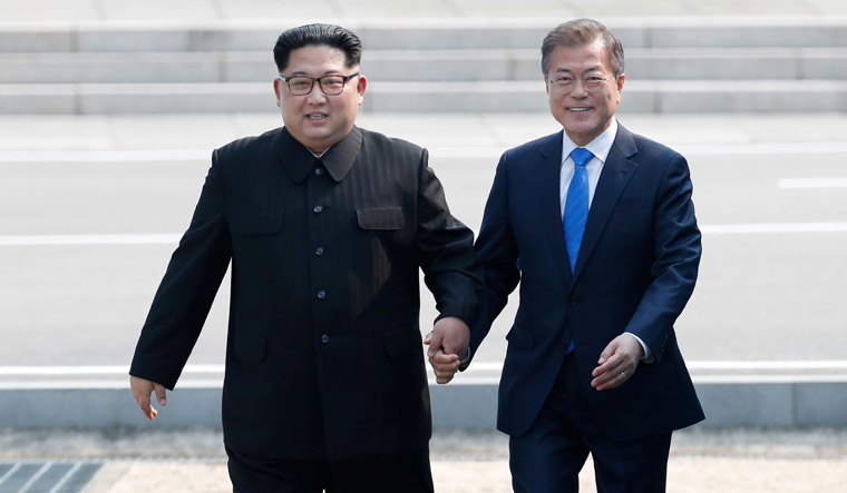 South Korean President Moon Jae-in and North Korean leader Kim Jong Un meet in the truce village of Panmunjom inside the demilitarized zone separating the two Koreas | Reuters