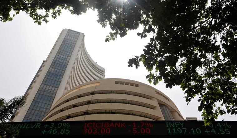Sensex ends in red as late sell-off reverses early gains down