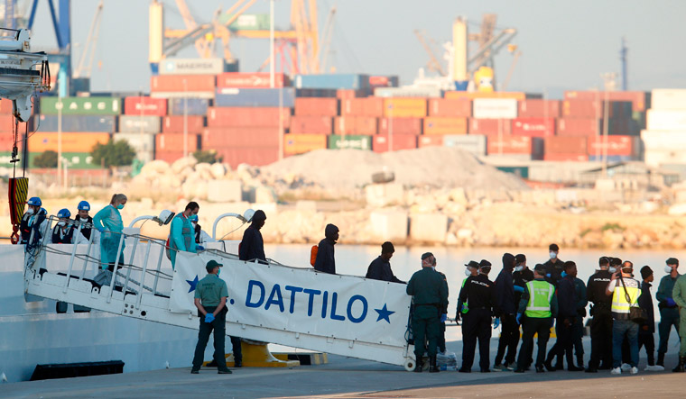 Migrants rocked by EU political storm start to arrive in Spain