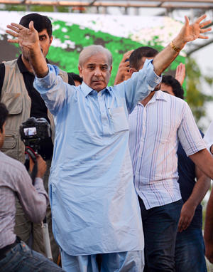 Shahbaz Sharif (C), the younger brother of ousted Pakistani Prime Minister Nawaz Sharif and head of Pakistan Muslim League-Nawaz (PML-N), greets supporters upon his arrival for a campaign meeting in Pindi Gheb, in the district of Attockm, in the Punjab province | AFP