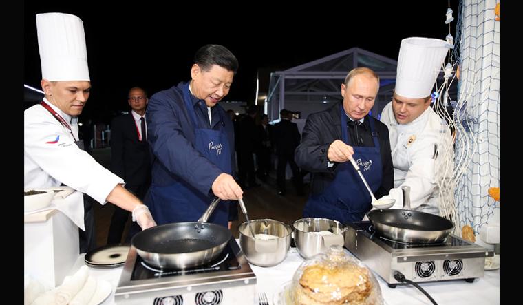 putin-xi-pancake-reuters