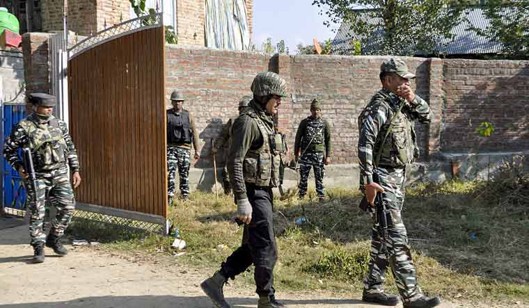 [File] Security personnel patrol near a polling station during the first-ever Block Development Council elections, at Lassipora in Pulwama district of South Kashmir   PTI