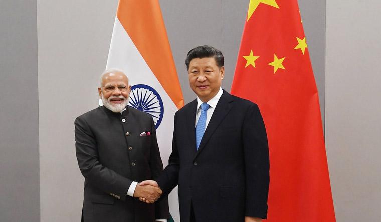 modi-xi-jinping-meet-BRICS-India-China-PTI-PIB