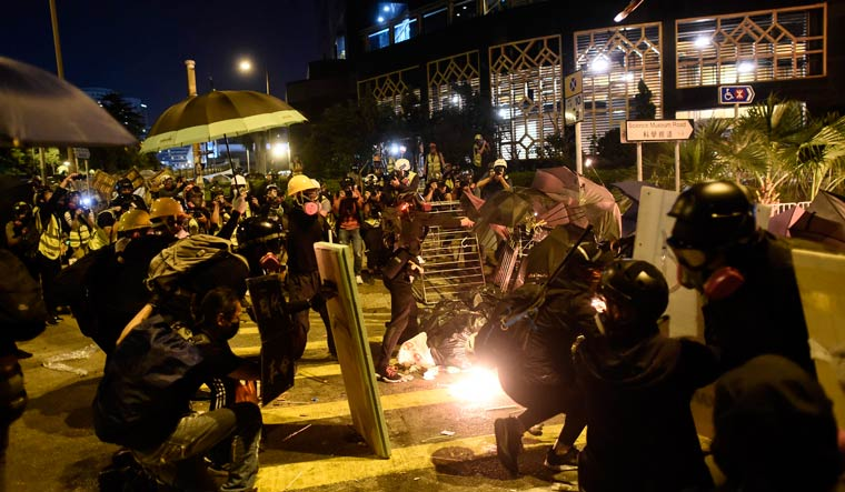 Protestors clash with police outside the Polytechnic University of Hong Kong in Hung Hom district | AFP