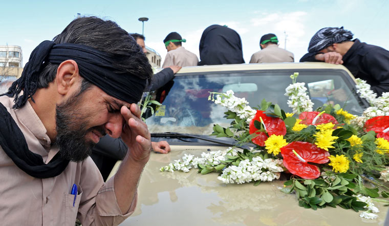An Iranian man cries during the funeral of 27 Revolutionary Guards, who were killed in a suicide attack, in southeastern city of Isfahan   AFP