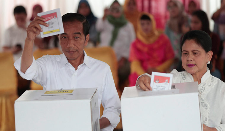 Voting under way in Indonesia in its biggest-ever election