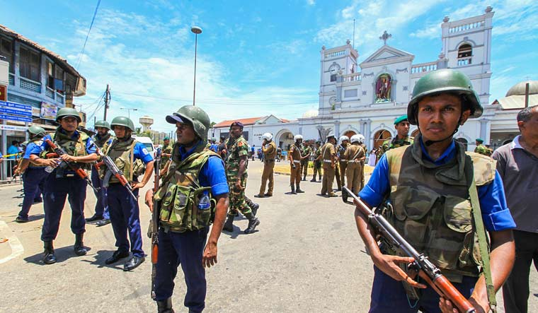 Sri Lankan Army soldiers secure the area around St. Anthony Shrine after a blast in Colombo | AP